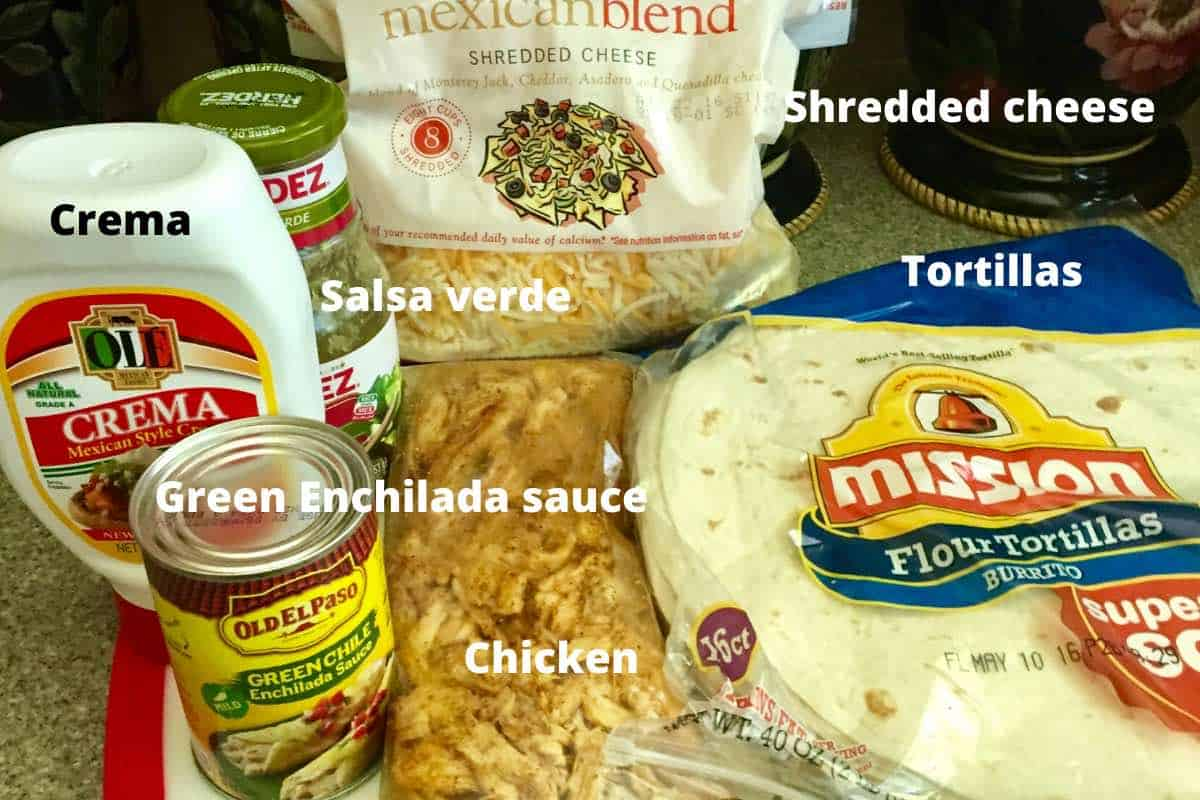 Enchilada ingredients including tortillas, enchilada sauce, salsa verde, and chicken.