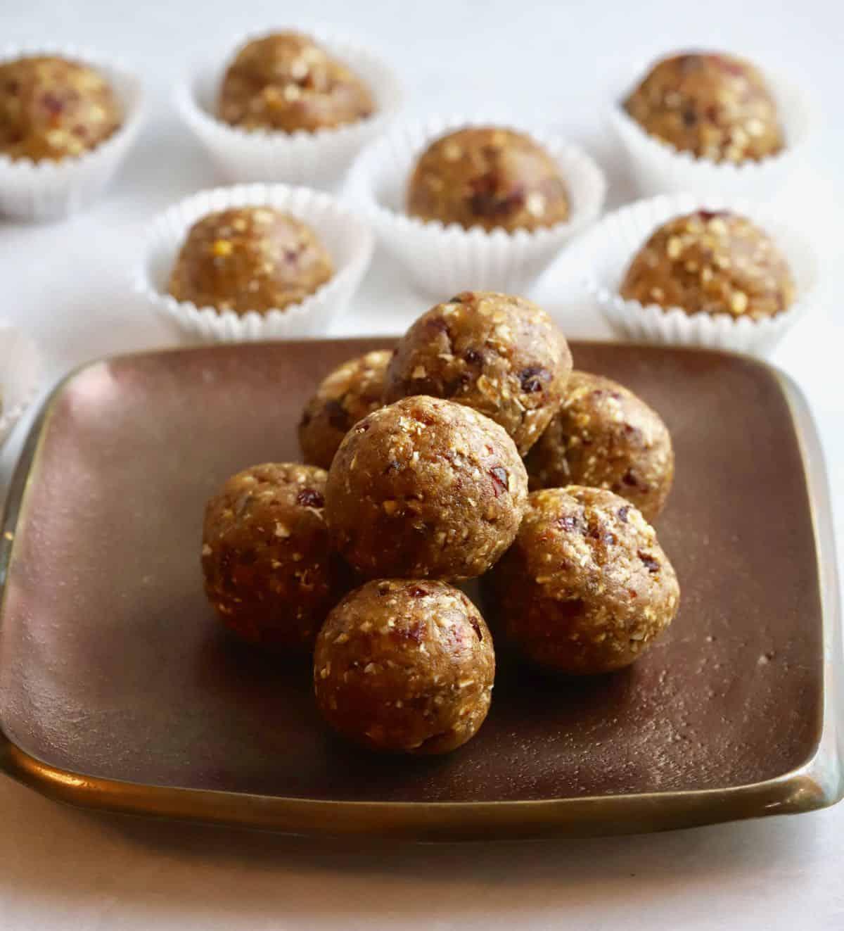 A bronze plate full of oatmeal energy balls.