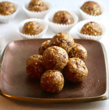 Seven energy balls stacked on a bronze plate.