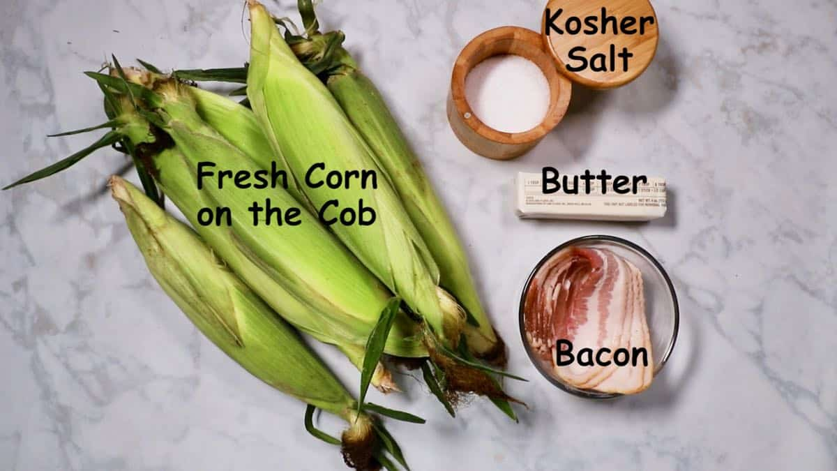 Six ears of corn, kosher salt, a stick of butter and raw bacon.