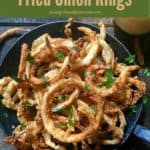 Pinterest pin, onions rings in a cast iron skillet.
