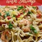 Pinterest pin, with pasta, pesto, shrimp and tomatoes in a bowl.