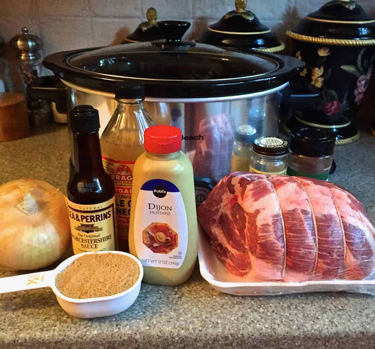 A crock-pot, boston butt roast, brown sugar and other ingredients.
