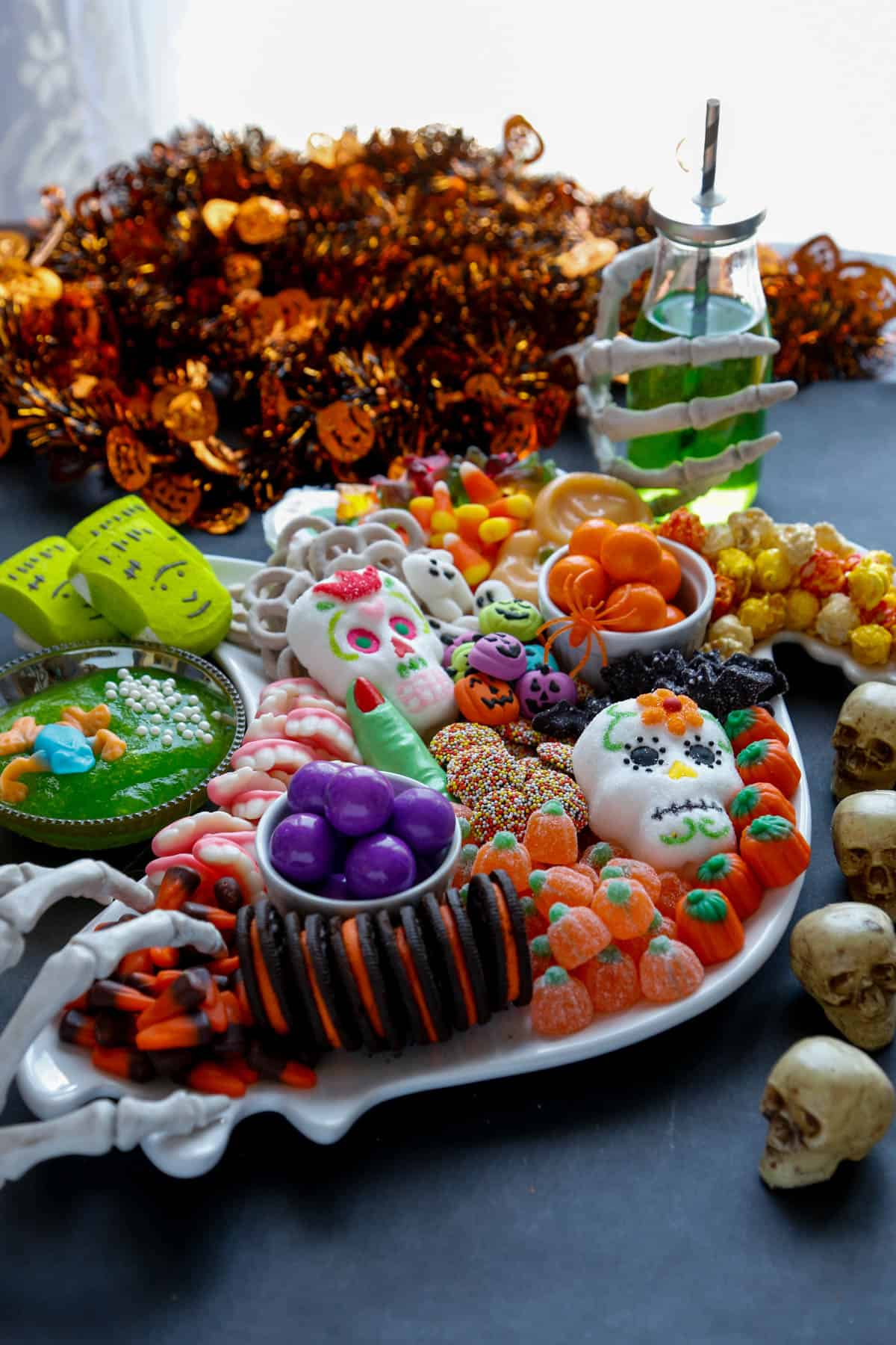Halloween charcuterie board full of different kinds of halloween candy.