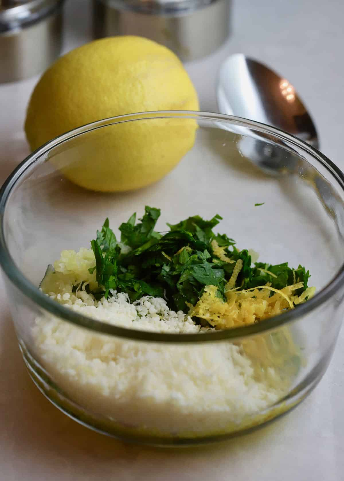 Parmesan cheese, lemon zest and parsley in a small bowl.