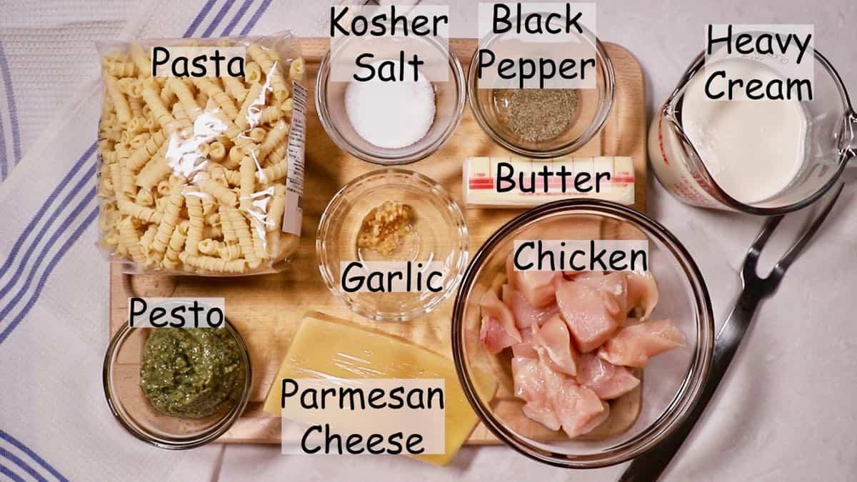 Recipe ingredients including pasta, pesto and chicken.