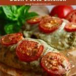 Pinterest pin showing two baked chicken breasts topped with cheese and sliced tomatoes.