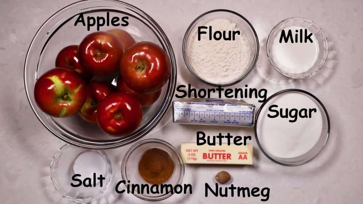 Ingredients for apple dumplings including a bowl of apples.
