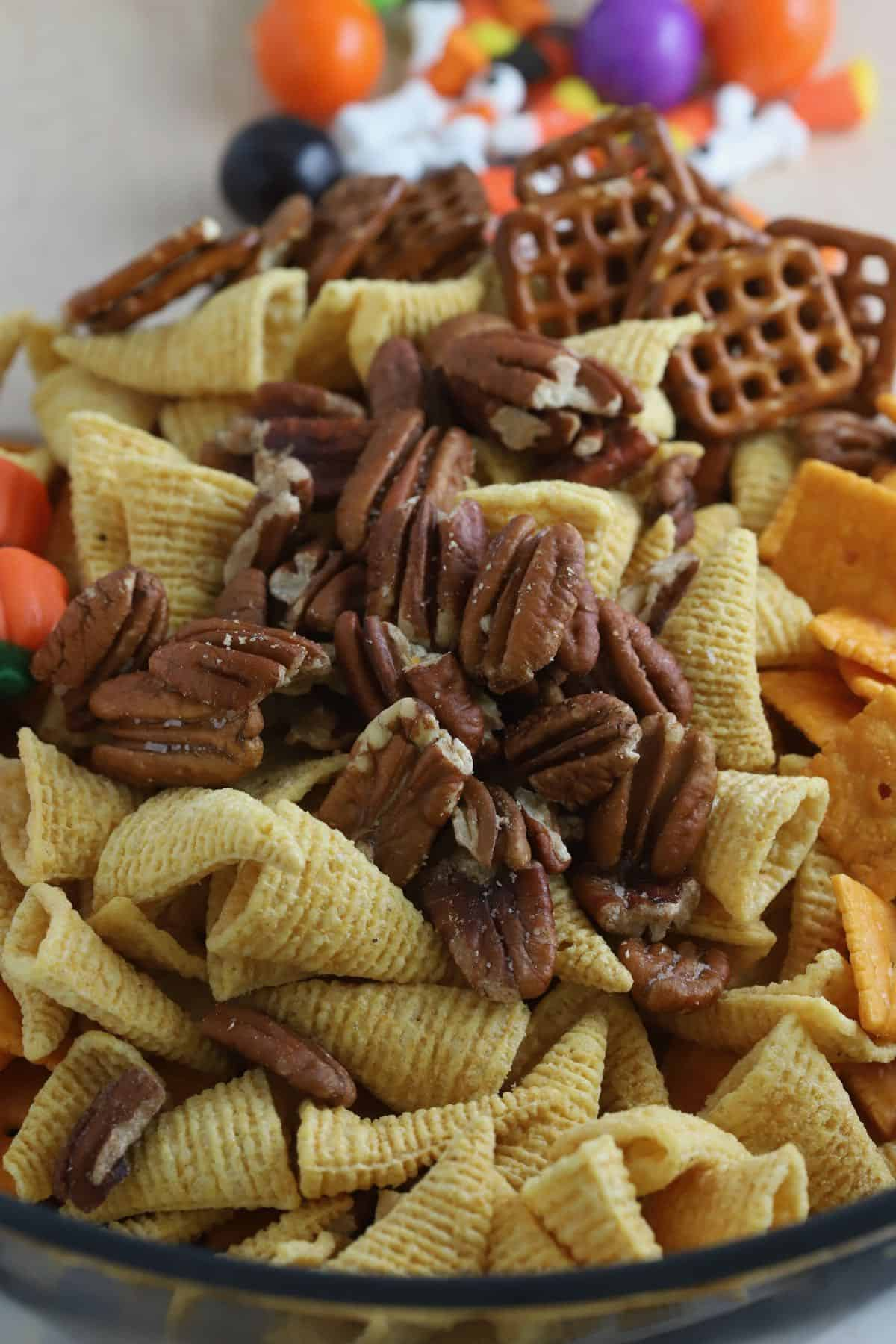 Snack mix made with Bugles and pretzels in a bowl.