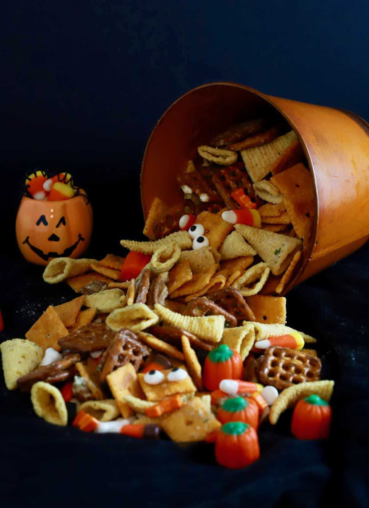 Halloween snack mix with Cheez-its, Bugles and pretzels.