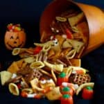 Monster Munch a Halloween Snack Mix falling out of an orange pail.