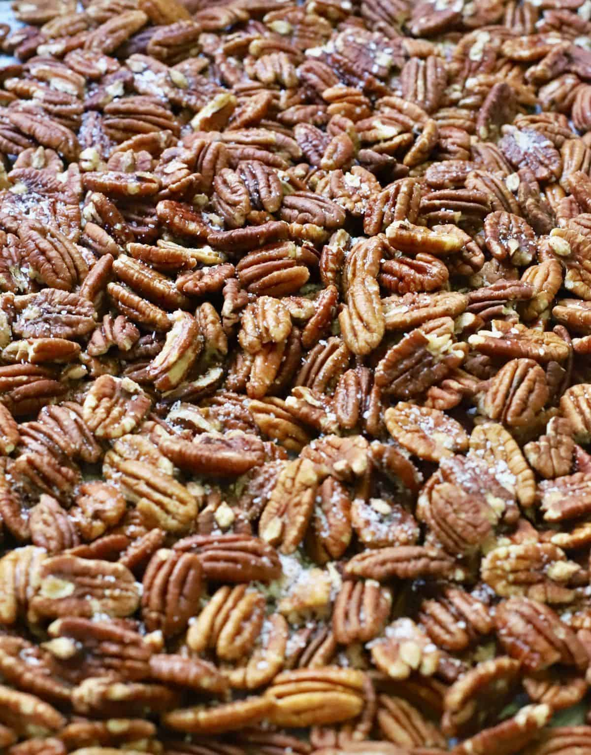 A pan full of roasted pecans.