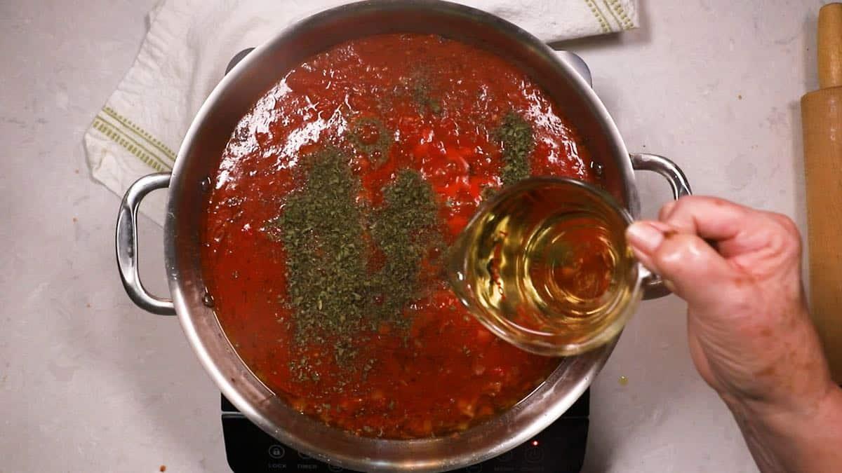 Cooking marinara sauce in a skillet.