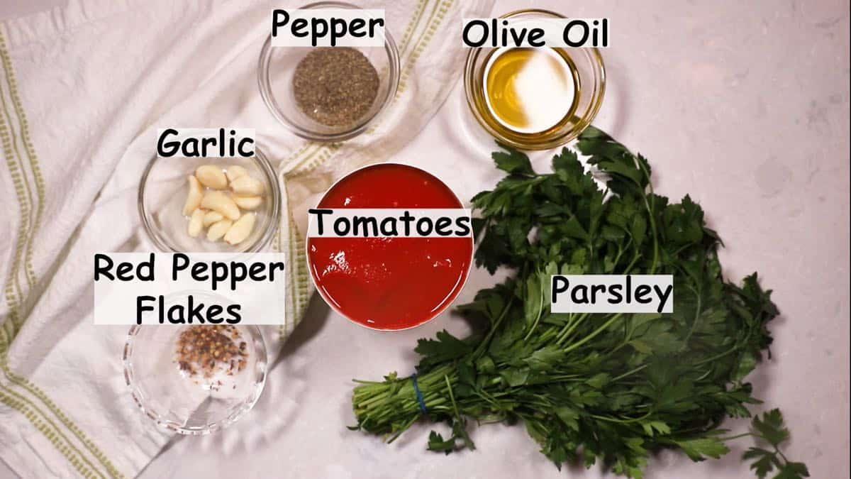 A can of tomatoes and other ingredients for marinara sauce.