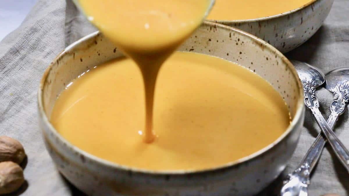 Pouring soup into bowls.