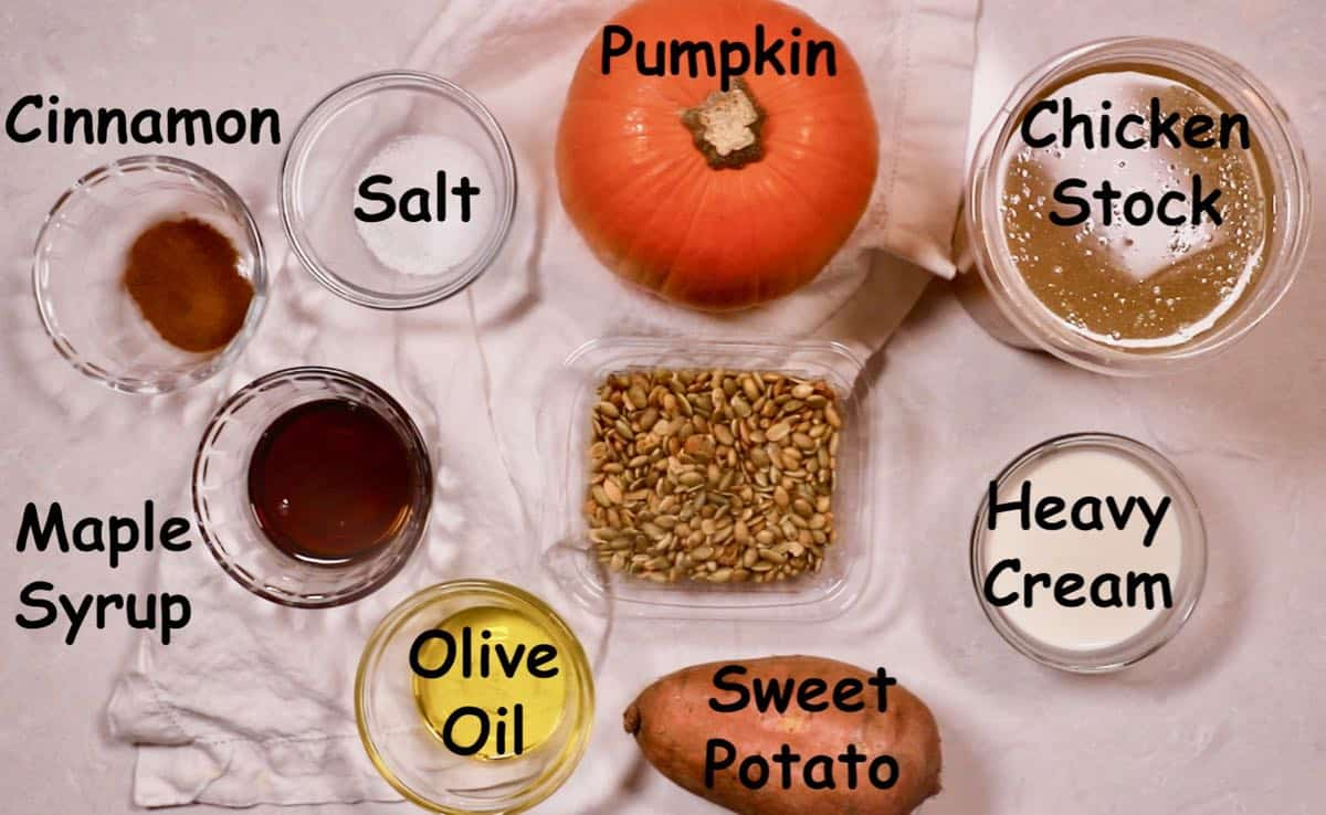 Recipe ingredients including a whole pumpkin and sweet potato.