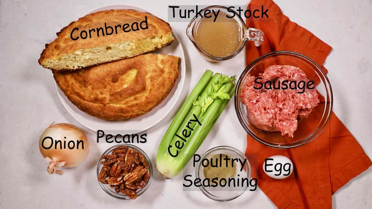 Ingredients for cornbread dressing, including cornbread, sausage and pecans.