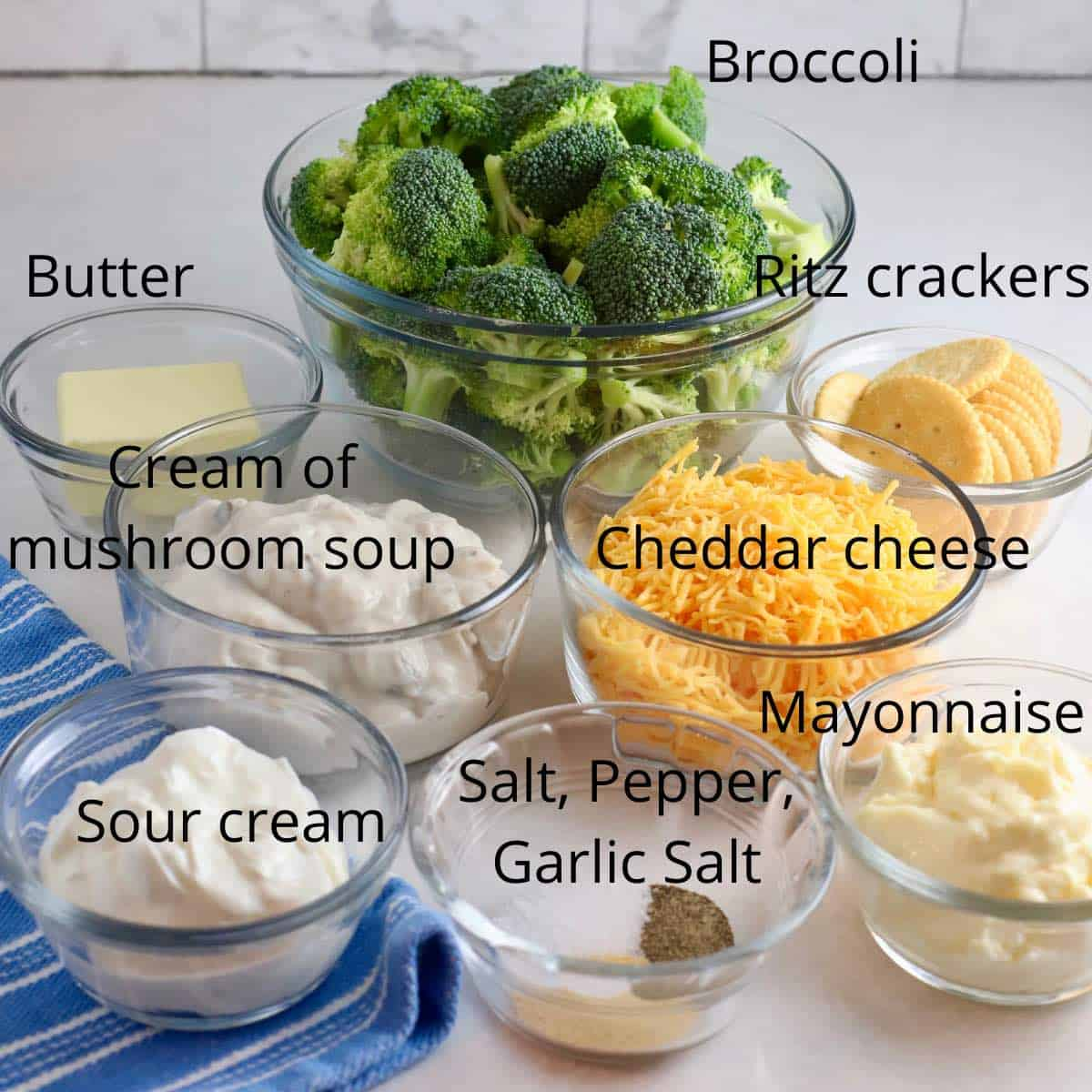 Ingredients for broccoli cheese casserole including broccoli, and sour cream.