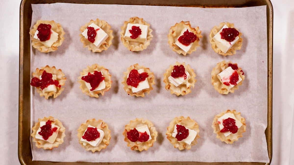 Cranberry brie bites on a baking sheet.