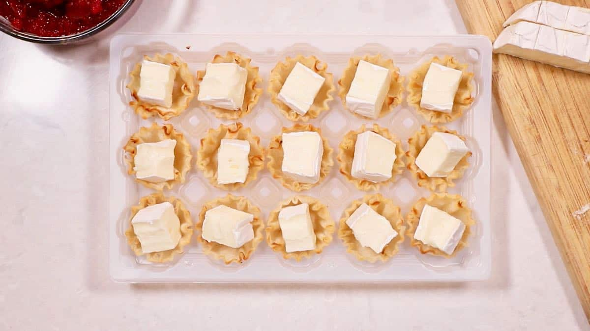 Filo cups with cubes of brie cheese.