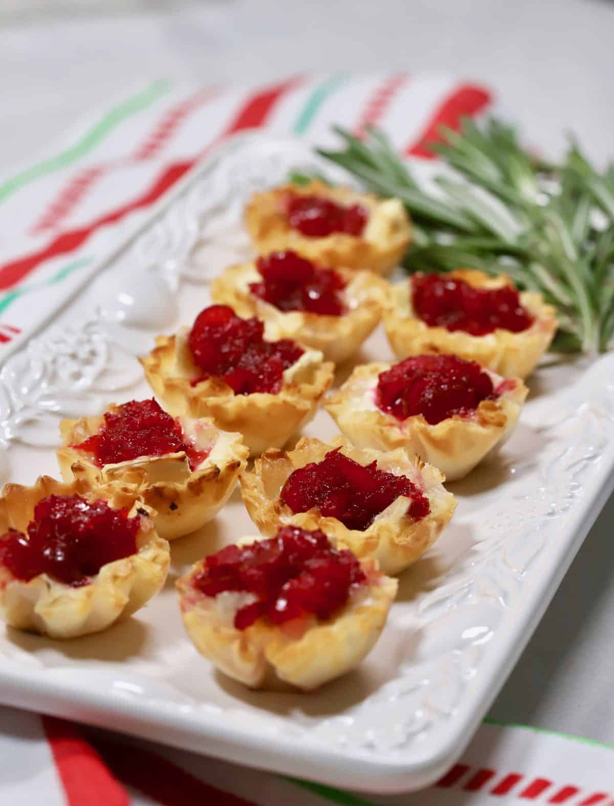 Cranberry Brie Bites on a white serving dish.
