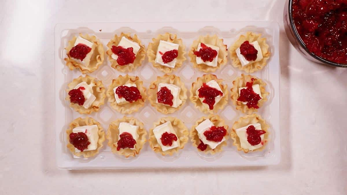 Filo shells with brie topped with cranberry sauce.