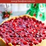 Cranberry cheesecake on a festive napkin, Pinterest pin.