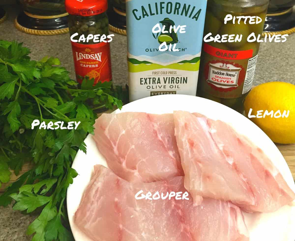 Ingredients including grouper fillets for a fish recipe.