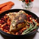 Roasted turkey breast with sweet potatoes and cranberries in a skillet.