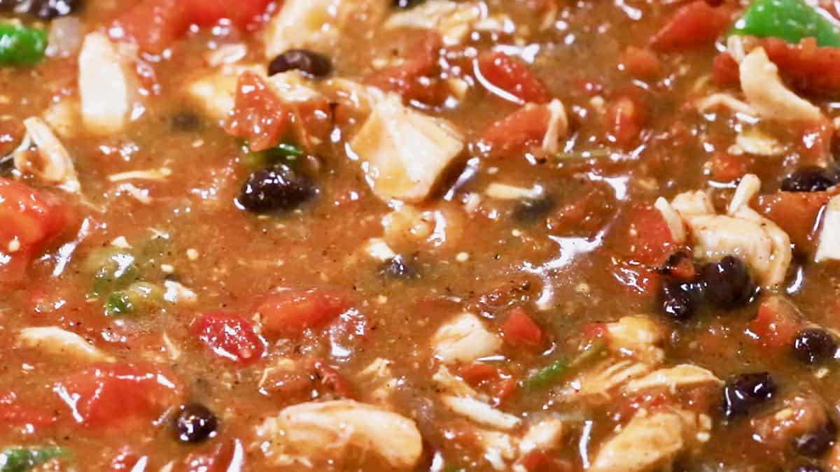 Chili simmering on a stove.
