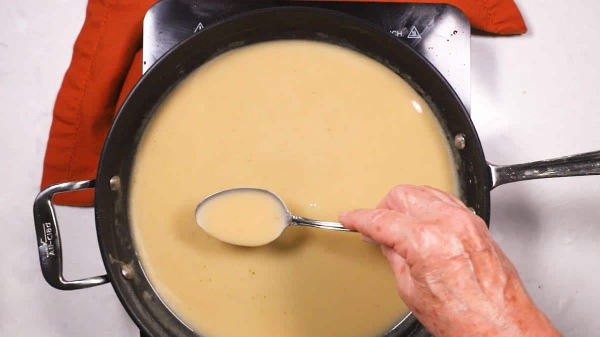 Turkey pan gravy in a skillet.