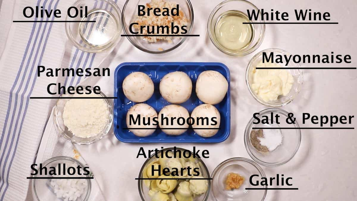 Mushroom caps, artichoke hearts, and other ingredients for stuffed mushrooms.