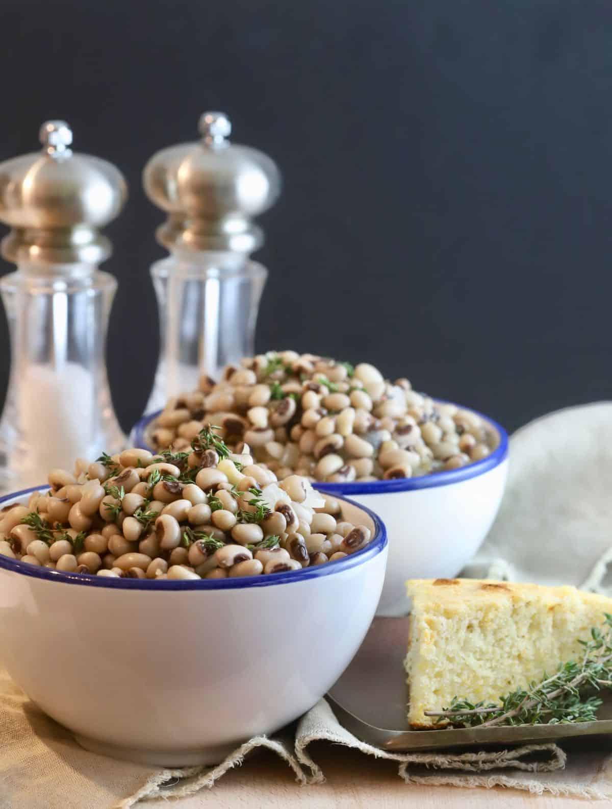 White bowls full of black-eyed peas.