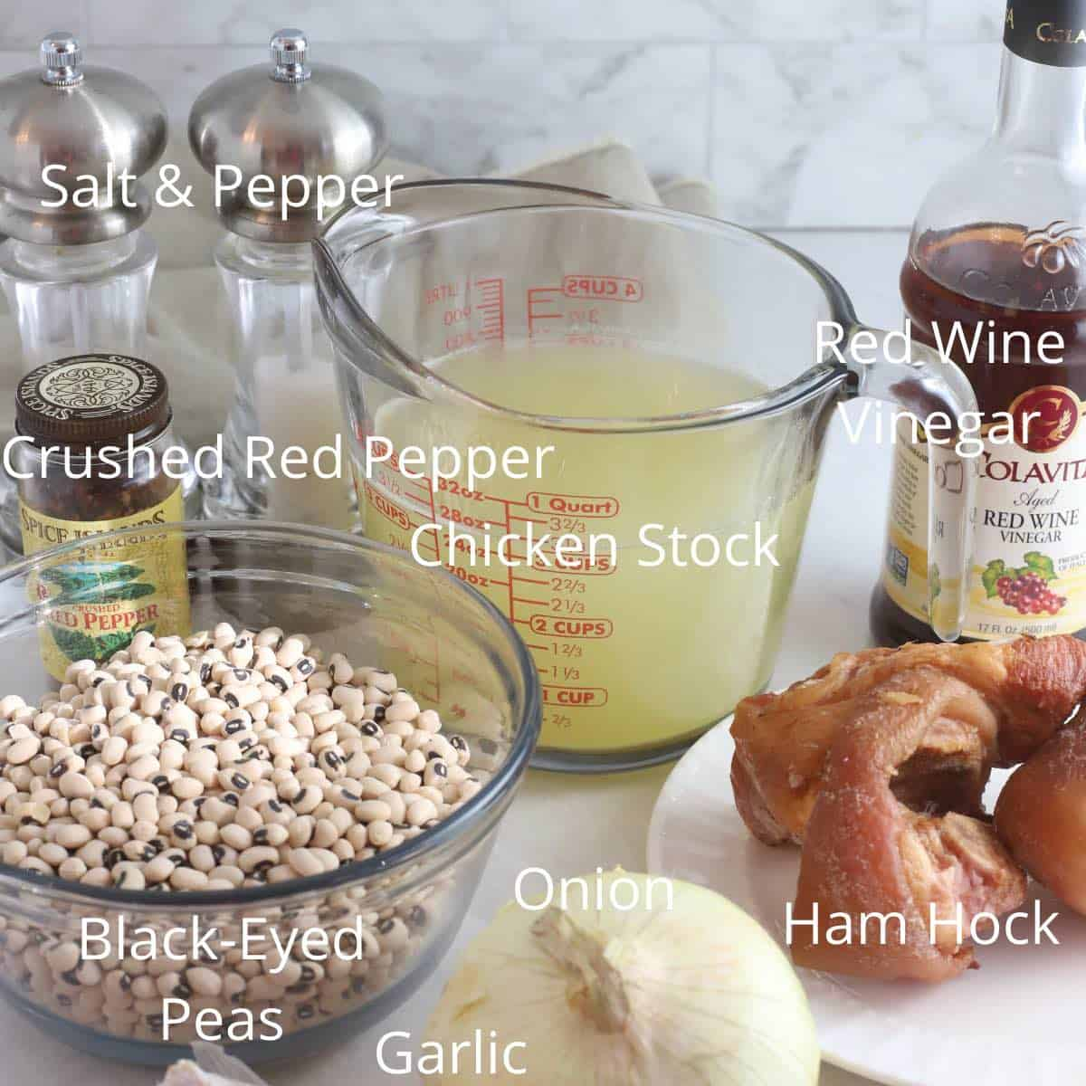 Ingredients to make black-eyed peas including dried peas, chicken stock and a ham hock.