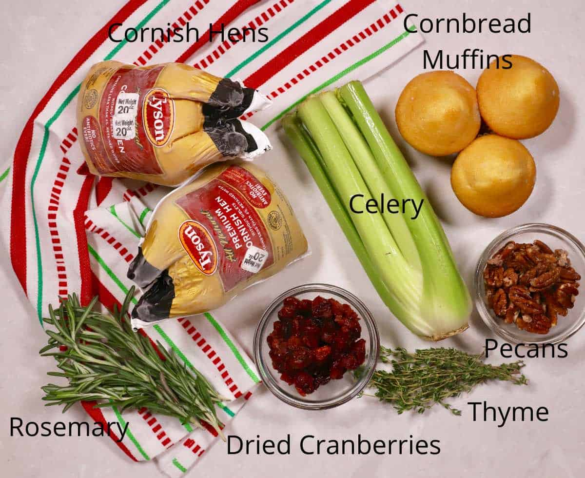 Ingredients for Stuffed Cornish Hens including celery, cornbread muffins and dried cranberries.