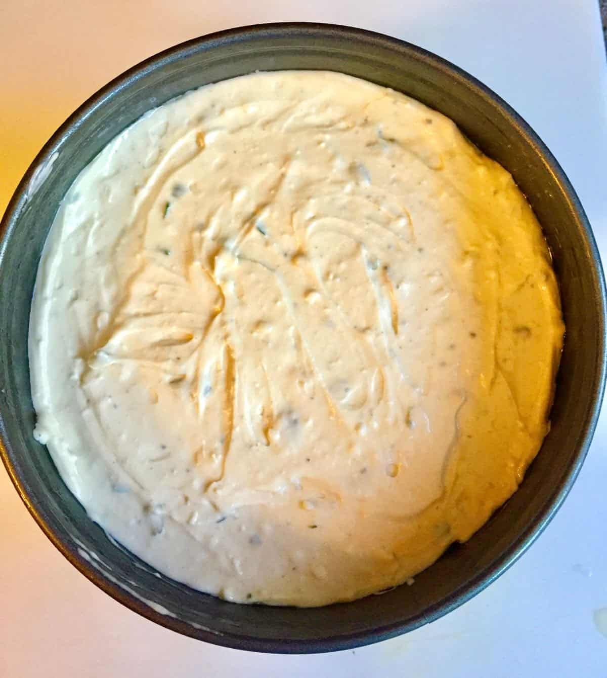 Cheesecake batter in a springform pan.