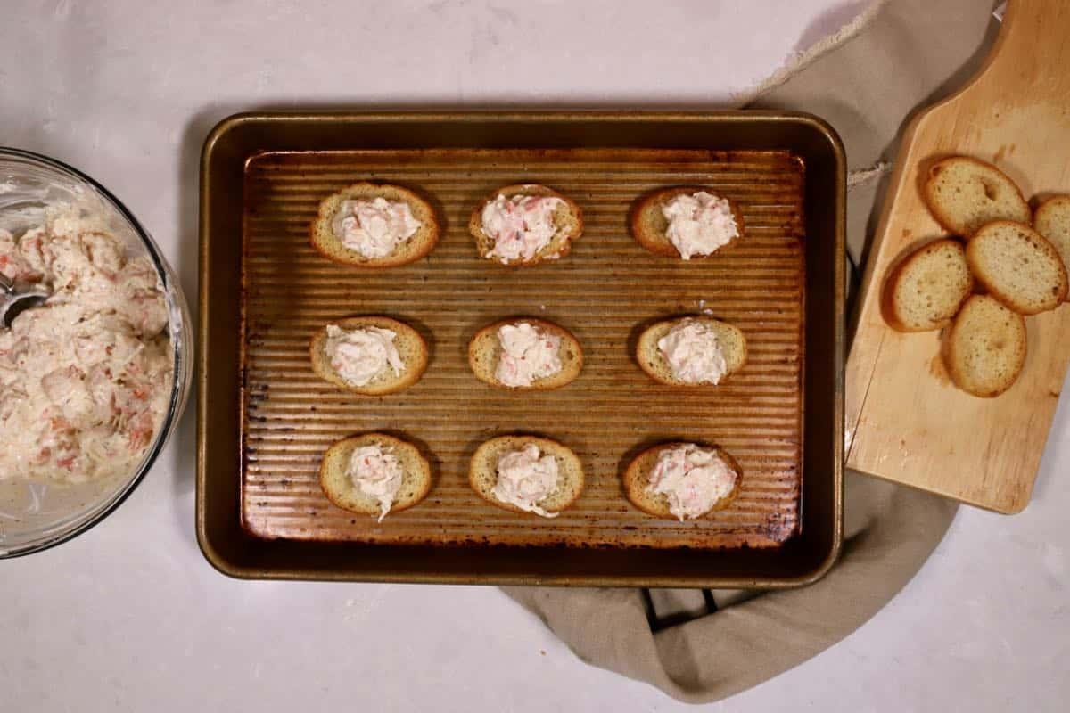 Shrimp toast on a baking sheet.
