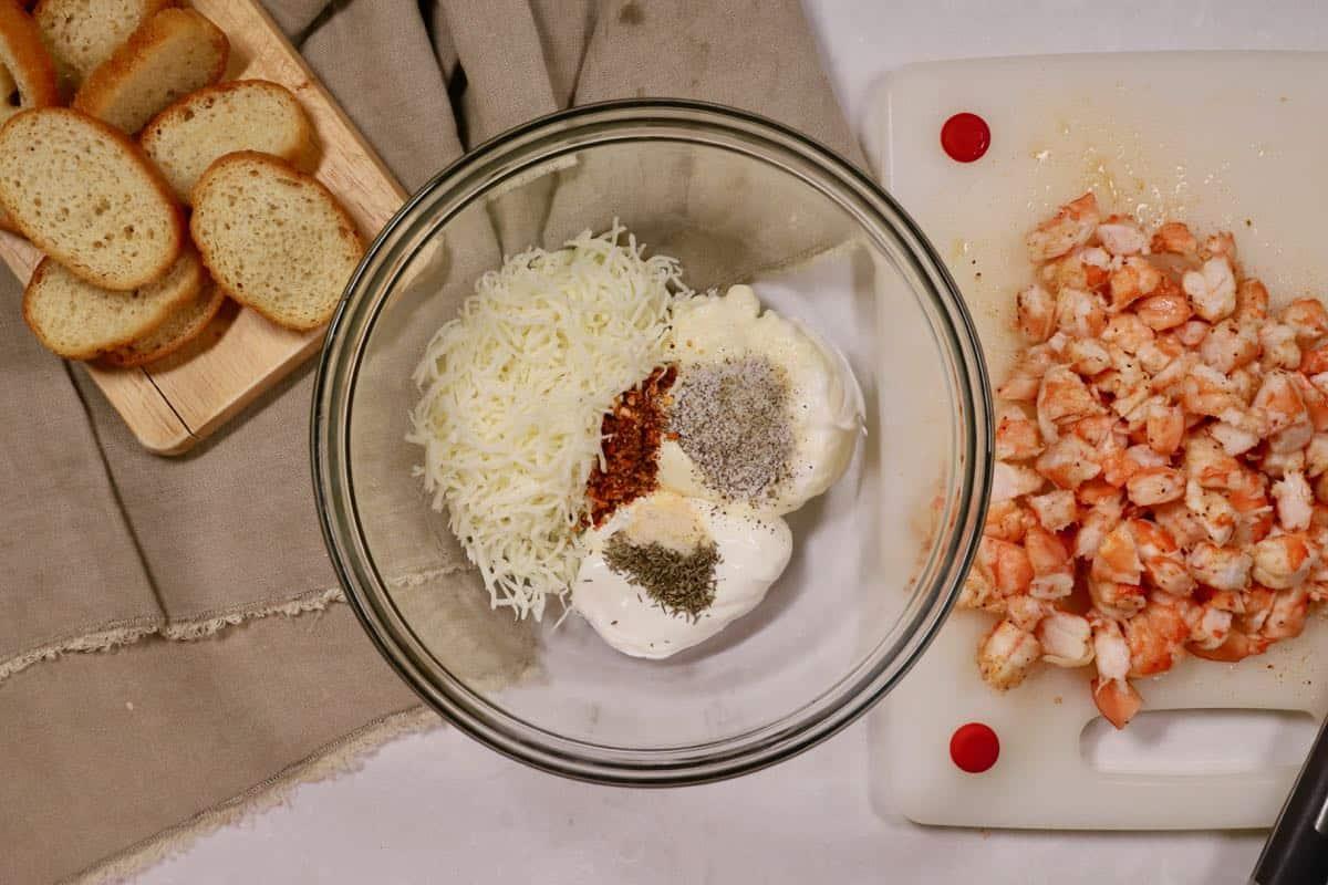 Cut up shrimp on a cutting board.