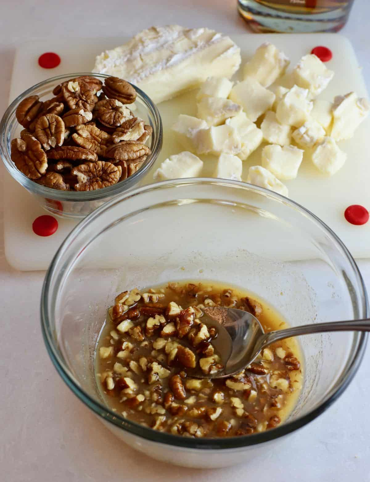 Bourbon, butter, pecans and brown sugar in a bowl.