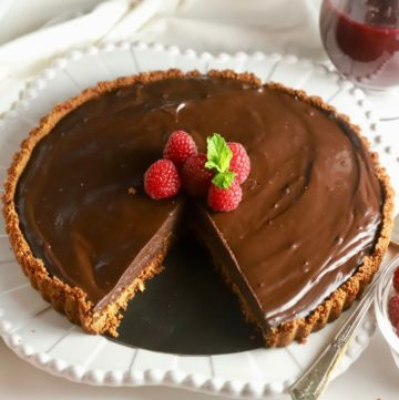Chocolate Ganache Tart with a slice cut out.