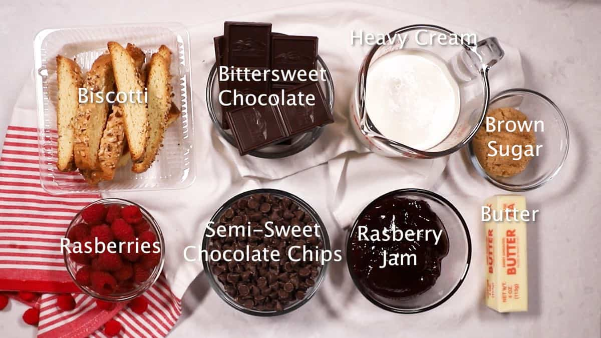 Ingredients to make a chocolate tart including semi-sweet and bittersweet chocolate pieces.