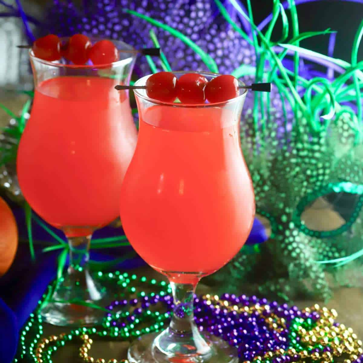 Twoo hurricane cocktails with Mardi Gras beads.