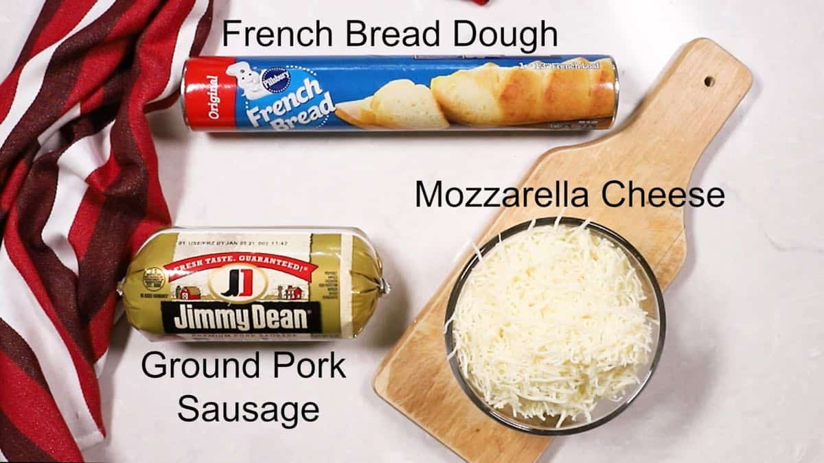 A can of French bread dough, sausage and mozzarella cheese.