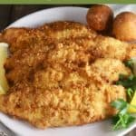 Pinterest pin showing fried fish fillets on a plate.