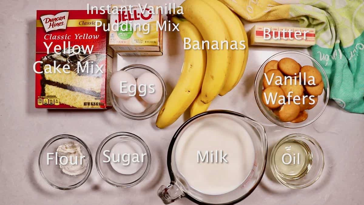 Ingredients for a banana pudding cake including cake mix and bananas.
