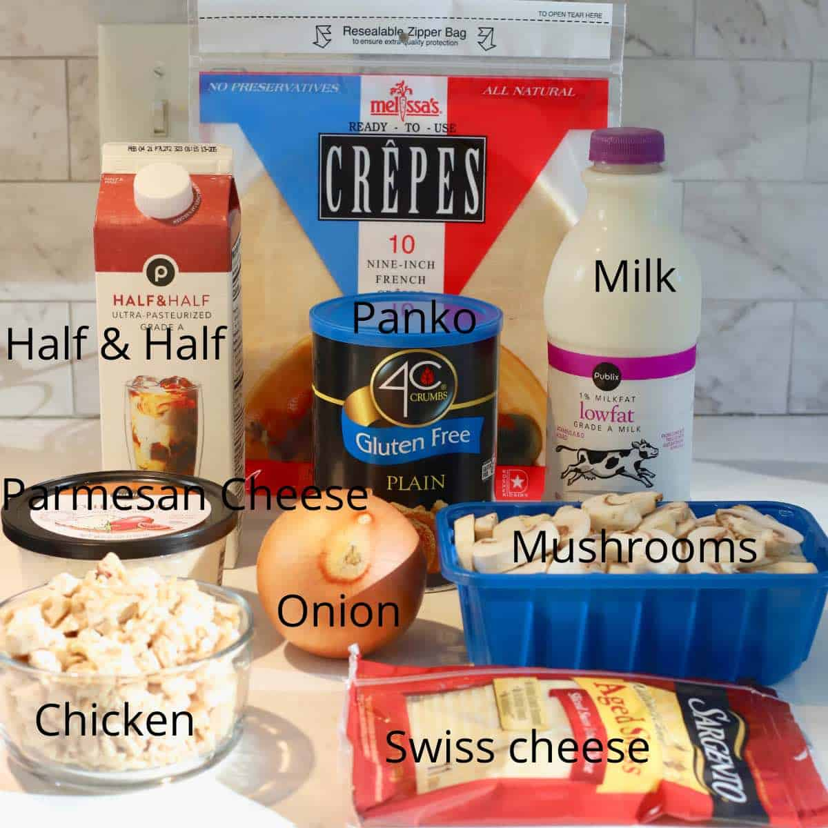 Ingredients for chicken crepes including mushrooms, chicken and half and half.