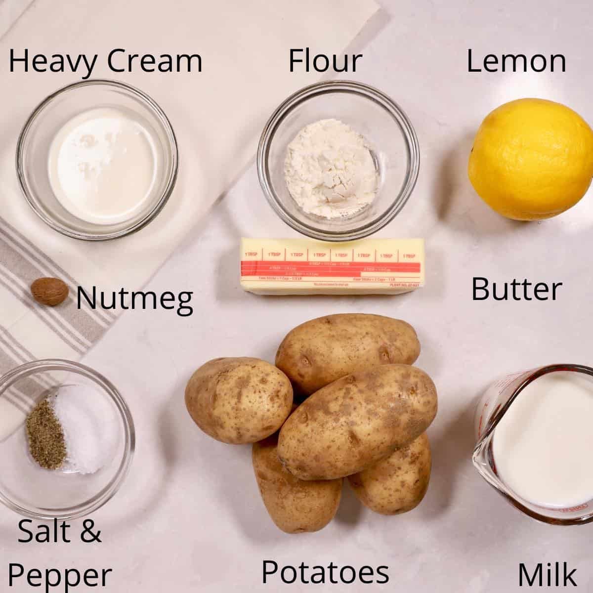 Ingredients for creamed potatoes including potatoes, milk and nutmeg.