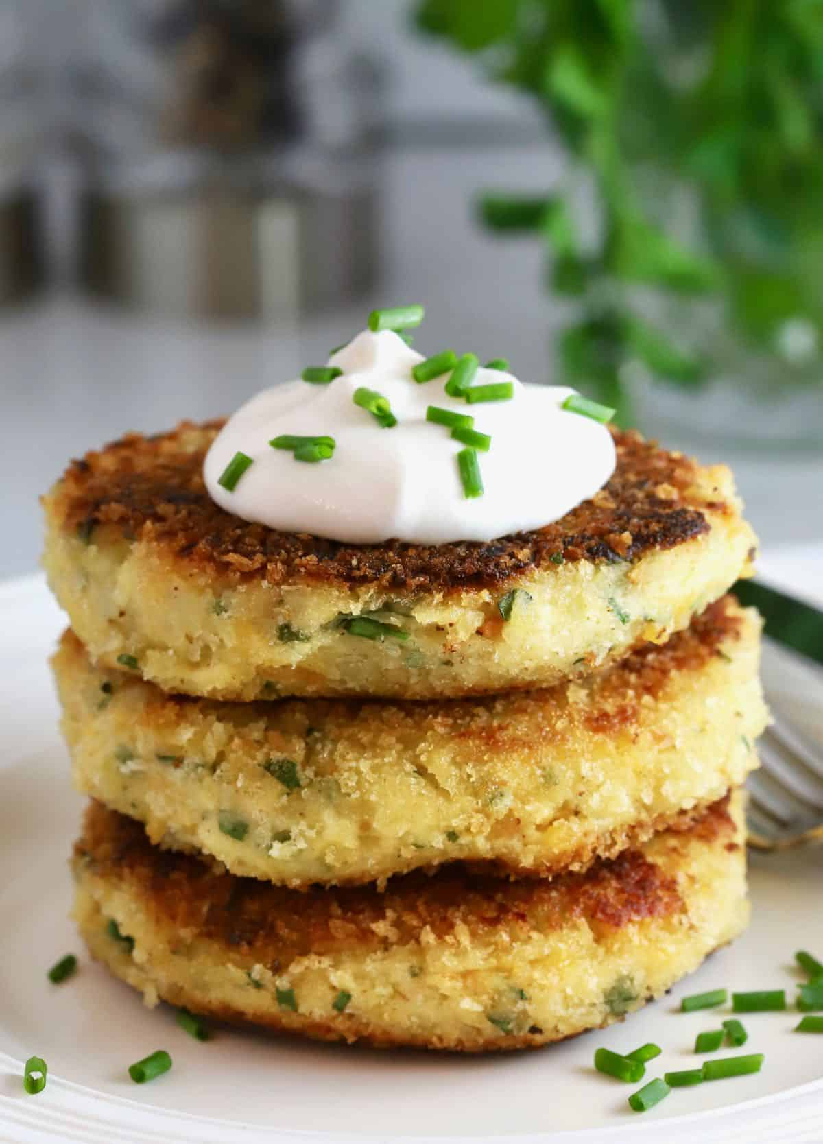 Potato fritters topped with sour cream and chives.