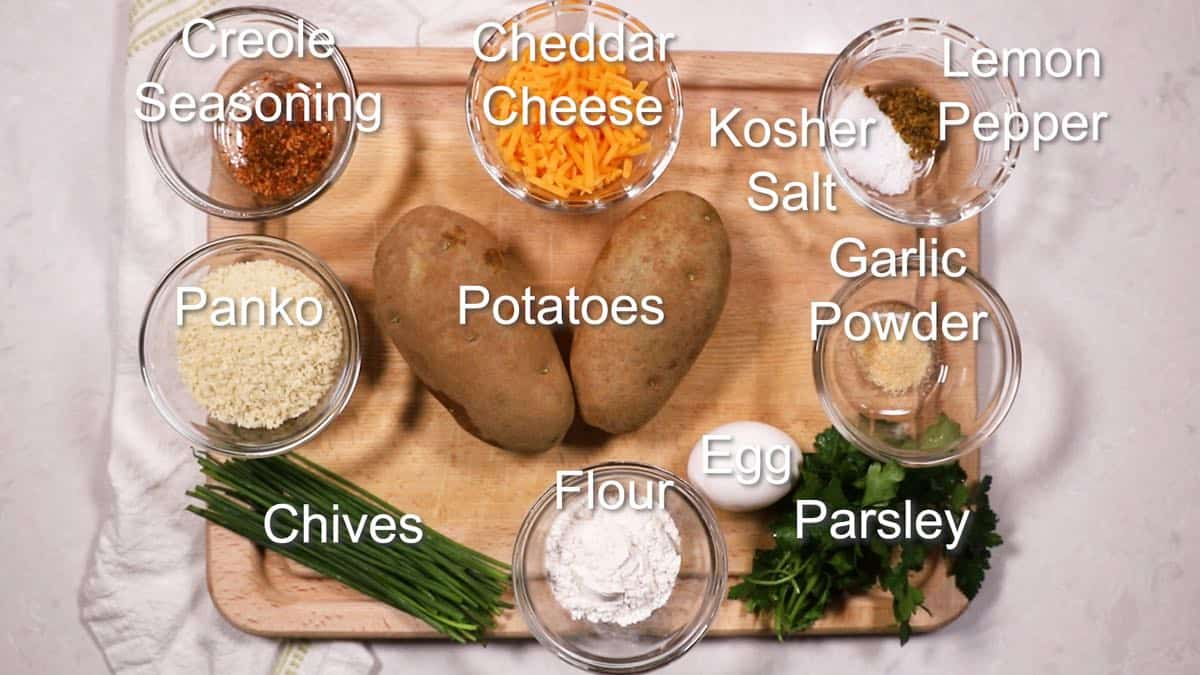 Ingredients to make potato fritters including cheese and potatoes.