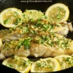 Pinterest pin showing pan-seared-fish-topped with gremolata.